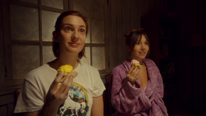 Waverly and Nicole look glamoured while they hold their cupcakes