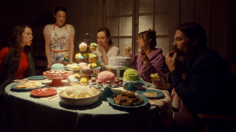 Jolene looks over Wynonna, Nicole, Waverly and Doc as they dig in