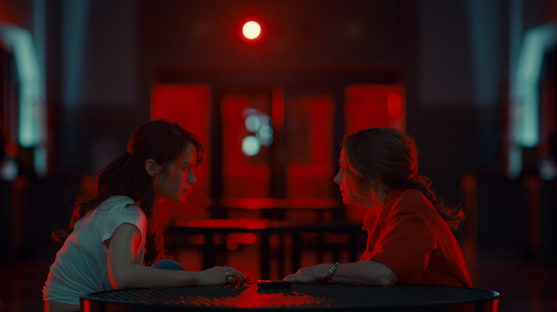 Waverly and Mama talk across a table