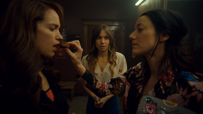 Jolene feeds Wynonna a brownie while Waverly looks on, despondent