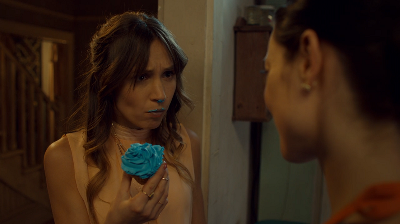 Waverly has blue frosting on her mouth and nose