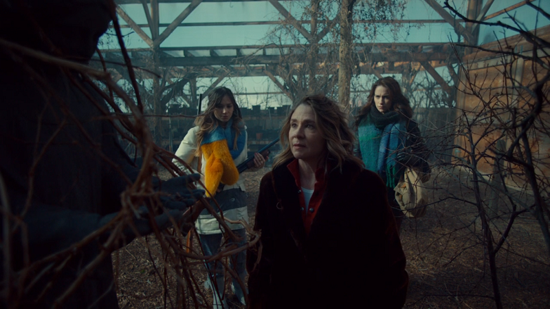 Waverly and Wynonna watch while Michelle fondles an angel statue