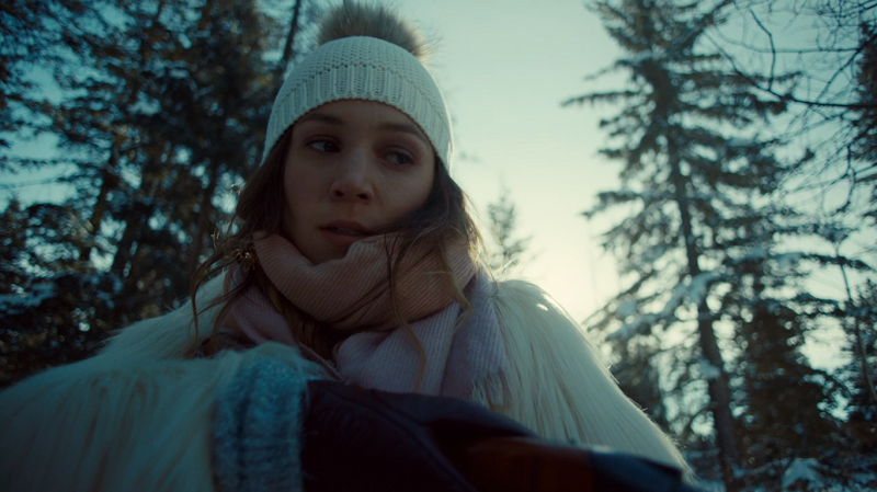 Waverly glares down the barrel of her gun into the well