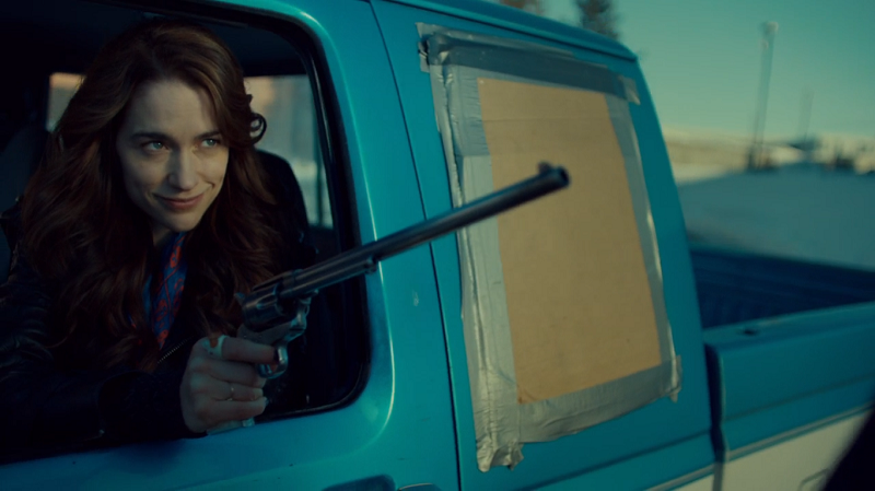 Wynonna smirks wildly while pointing her Peacemaker at Charlie Fire Services