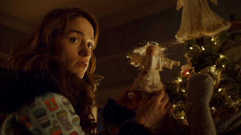 Wynonna holds up the tampon angel