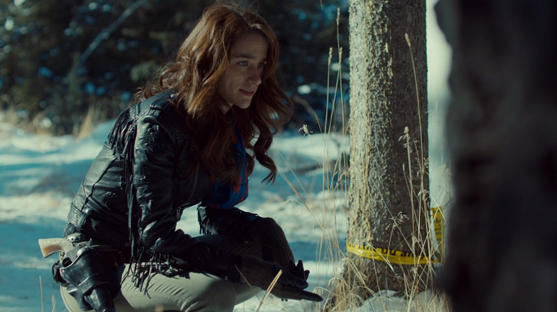 Wynonna crouches down to inspect evidence