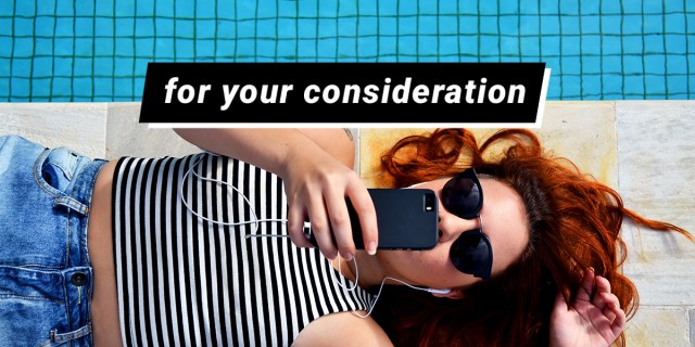 """for your consideration"" overlaid on a girl laying on the ground by the pool, scrolling through her phone"