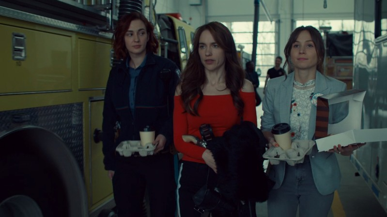 Nicole, Wynonna and Waverly walk out of the fire station