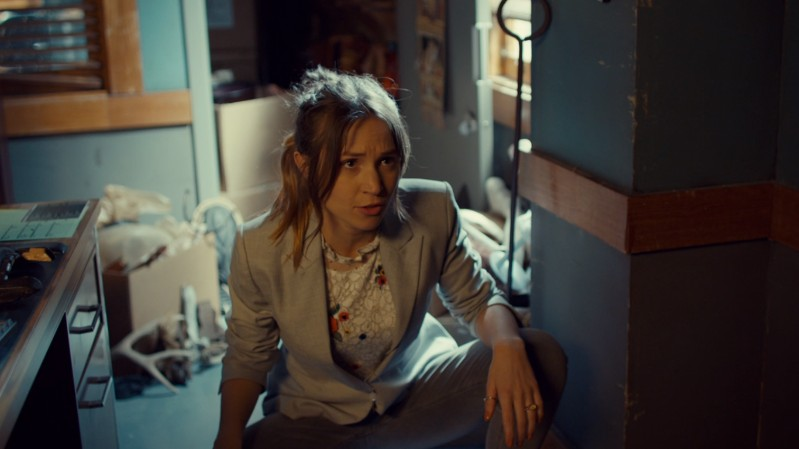 Waverly squats in her blazer like a gay