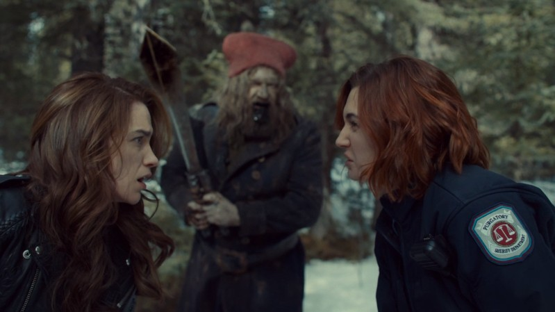 Wynonna and Nicole exchange ruh roh glances about the gnome man