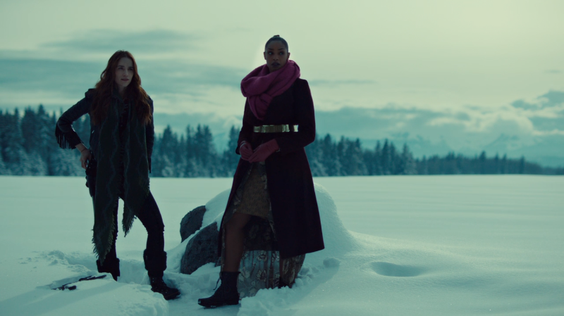 Kate and Wynonna stand on an expanse of snow