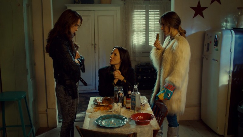 Waverly and Wynonna talk to Kevin while eating a pickle