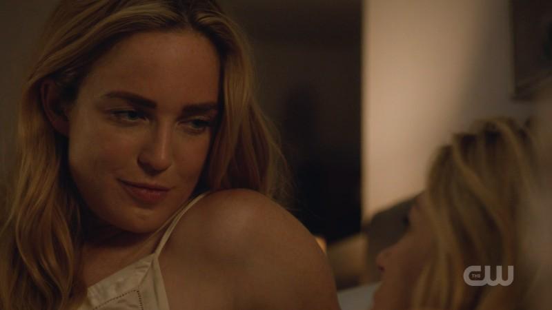 Sara smirks down at Ava