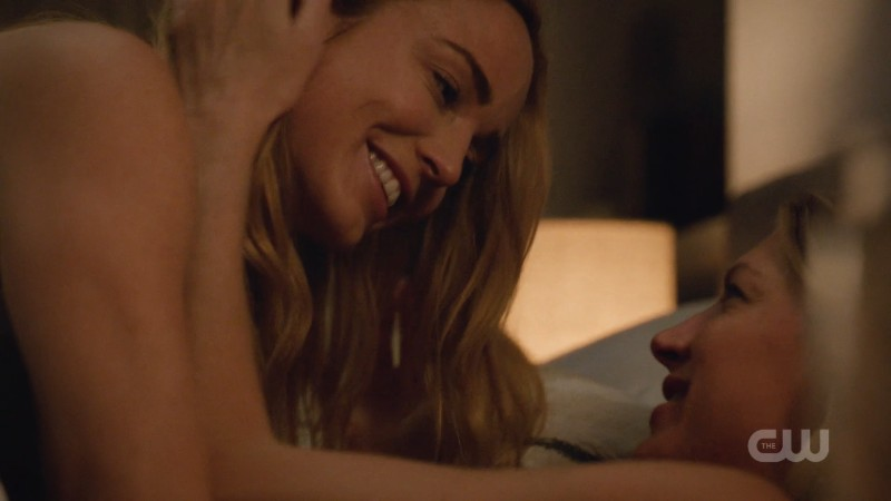 Sara and Ava hold each other joyfully in bed