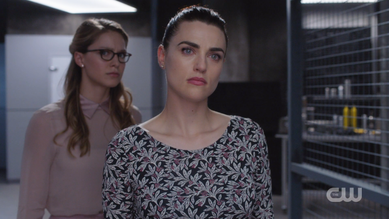 Lena stands in front of a nervous looking Kara