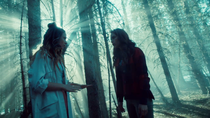 Waverly looks like she has a halo in the woods talking to Wynonna