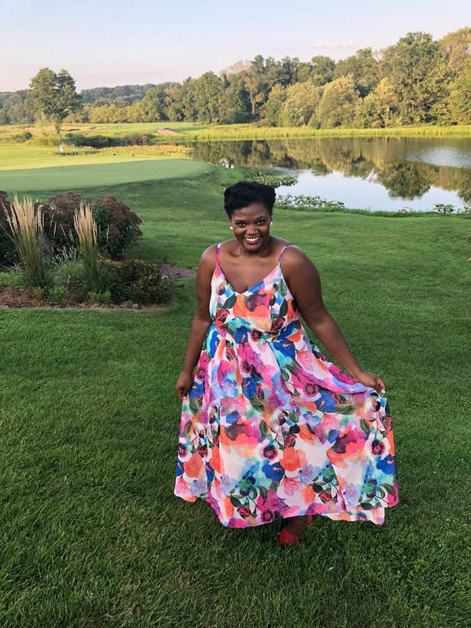 reneice charles in a floral sundress
