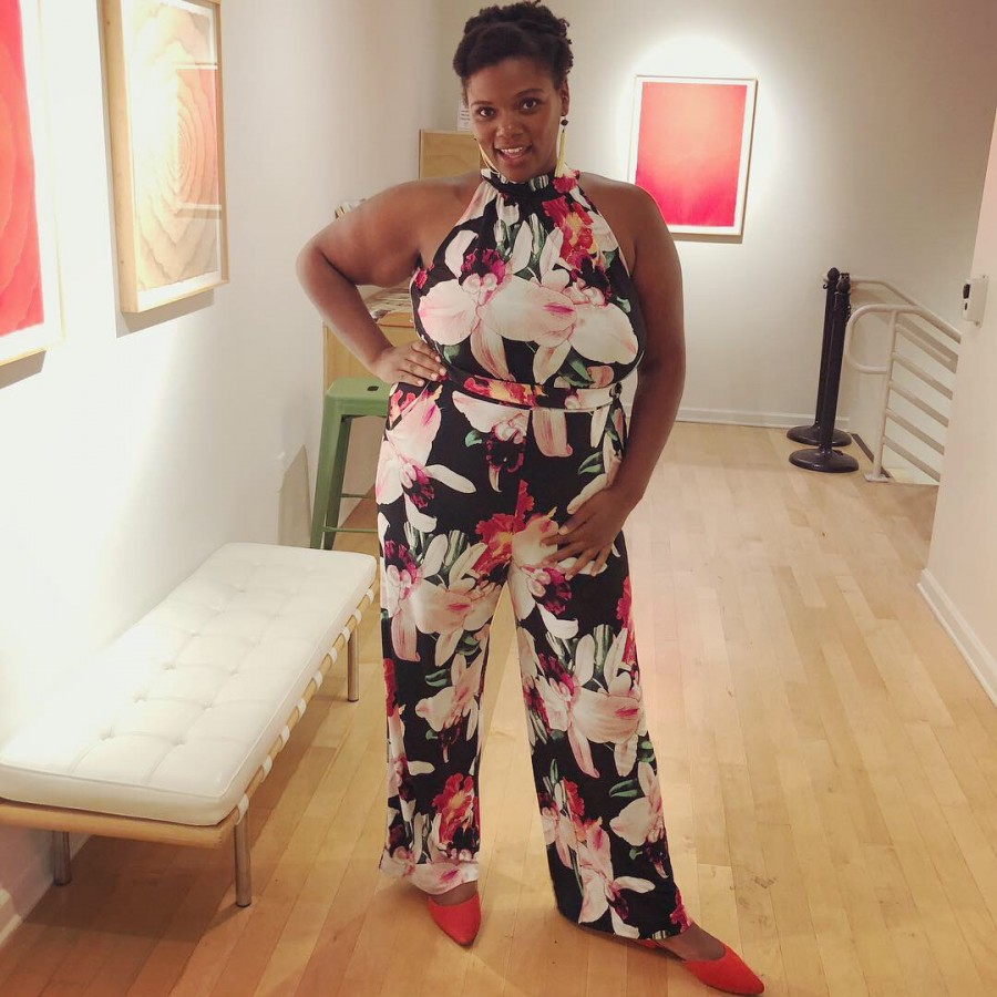 reneice charles in a floral pantsuit