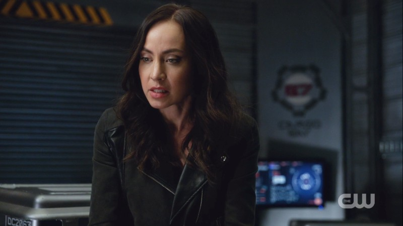 Nora is wearing a leather jacket in the dark