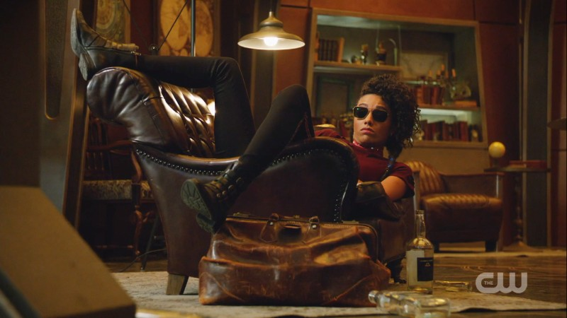 Charlie in sunnies draped over a couch