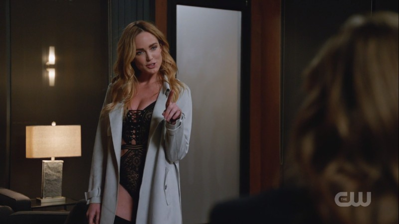 Sara points in her lingerie