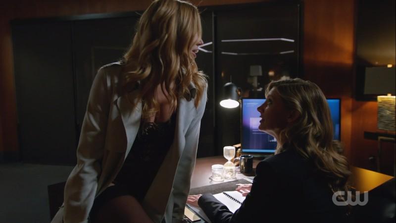 Sara sits on Ava's desk