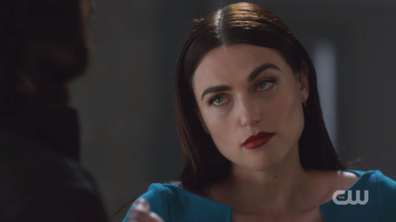 Lena cocks an eyebrow at Brainy
