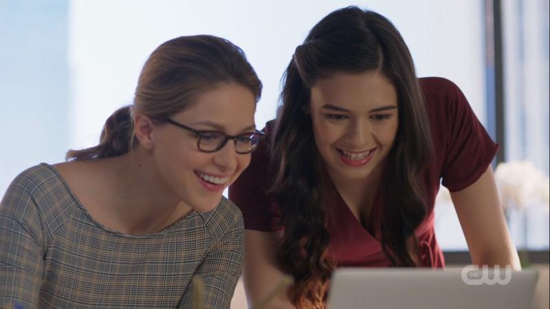 Kara and Nia look happily at the computer