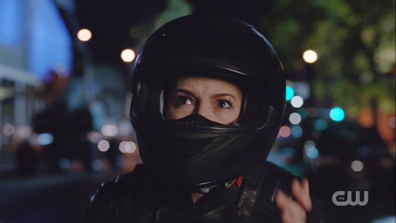Alex peeps out of her motorcycle helmet