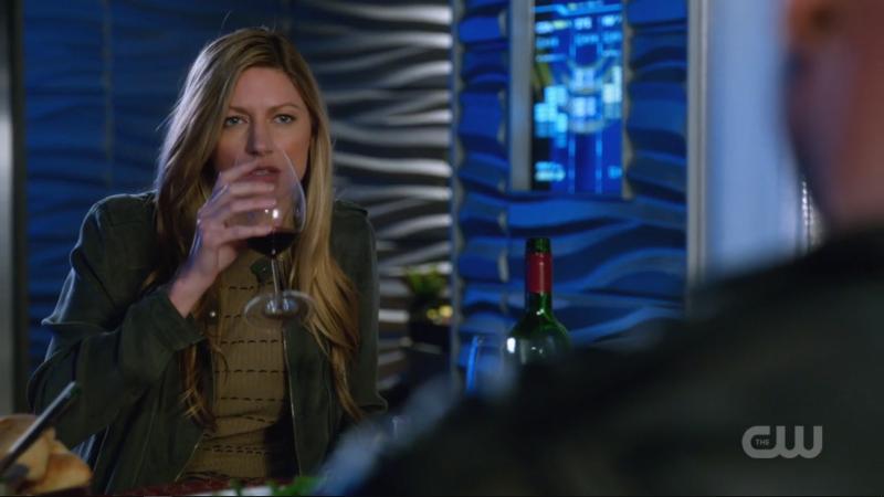 Ava sips her wine