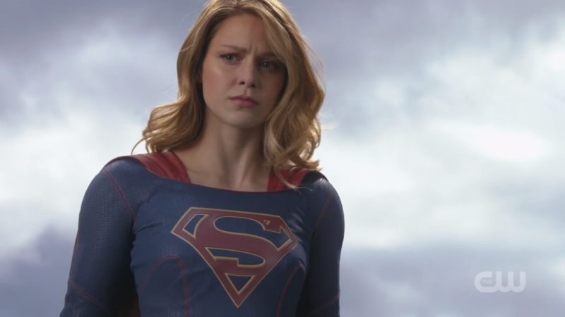 Supergirl hovers over the riot