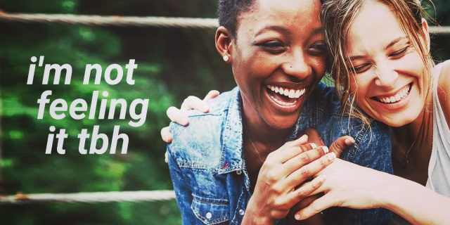 """two women holding hands laughing w the text """"i'm not feeling it tbh"""" overlaid on top"""