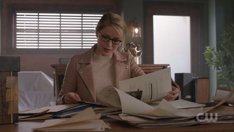 Kara looking through papers