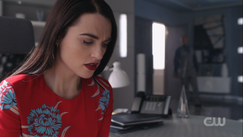 Lena looks worriedly at her phone