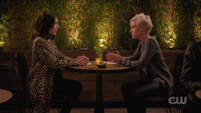 Valencia and Beth are across the table from each other at a romantic restaurant