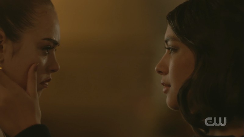 Penelope uses her thumb to brush Josie's single tear off her cheek
