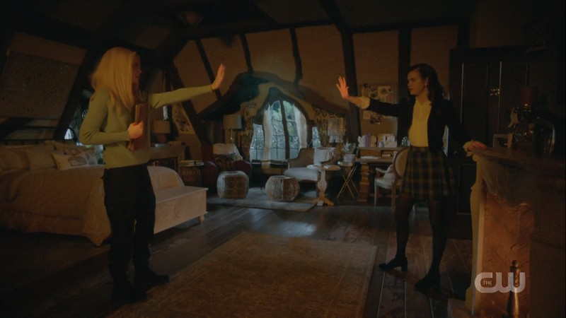 Josie and Lizzie throw spells at each other