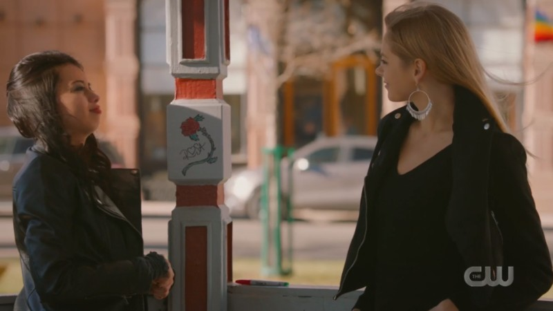 Rosa and Isobel chat while doing graffiti in a flashback