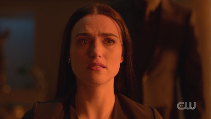Lena looks stressed and washed in red light