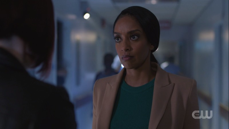 Kelly looks at Alex and decides to trust her