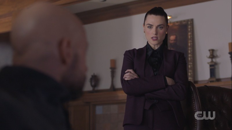 Lena in a suit crossing her arms