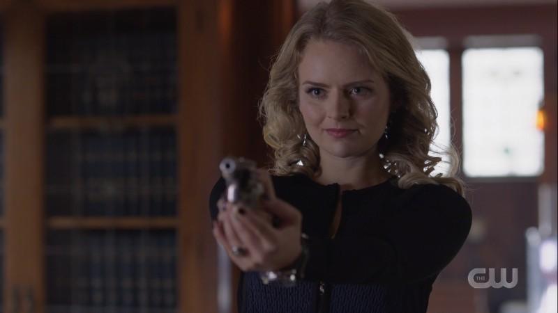 Eve points a gun at Lena