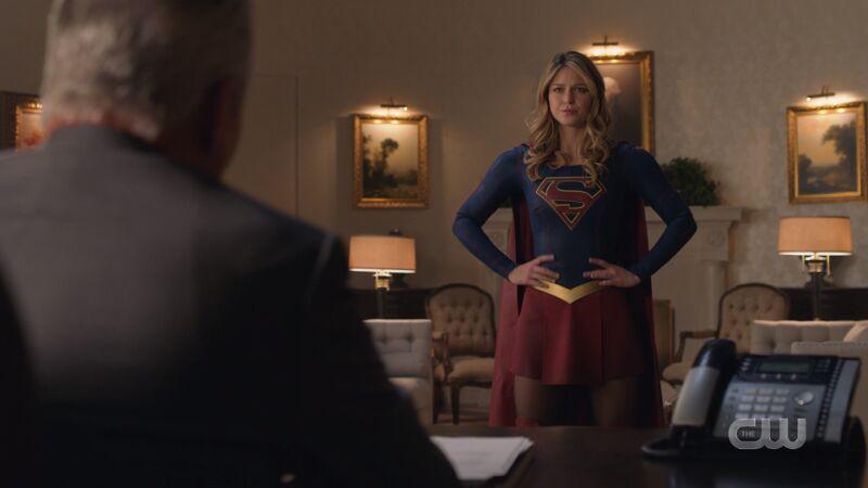 supergirl hands on hips