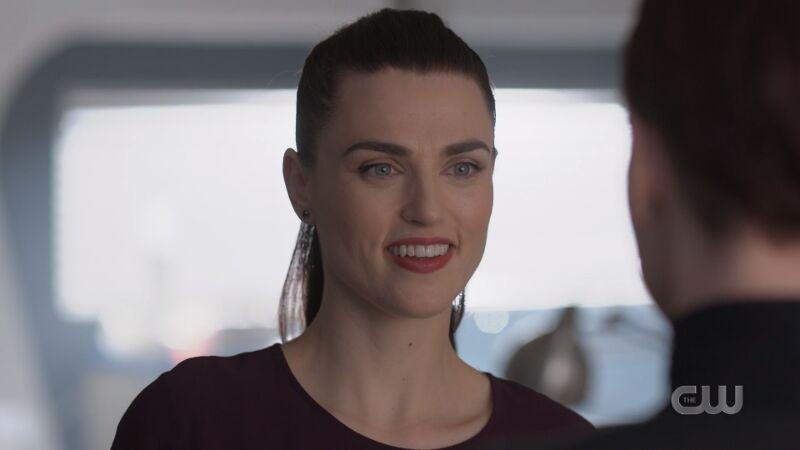 Lena smiles at Alex