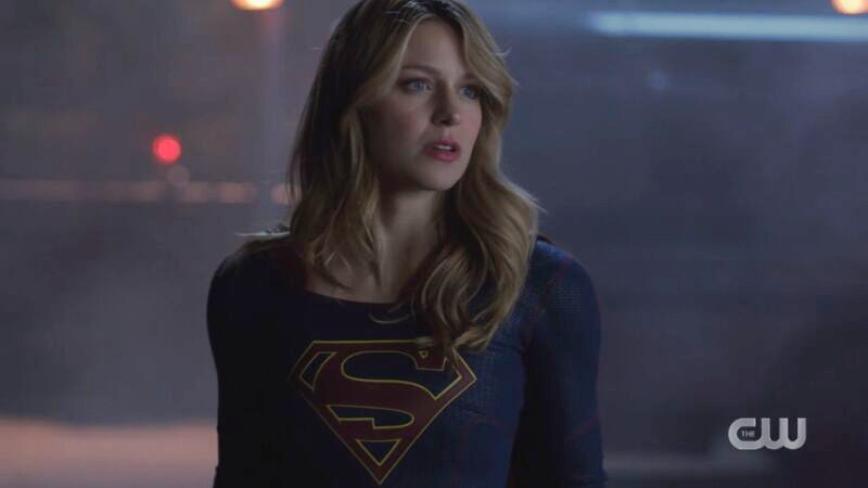 Supergirl stands proudly