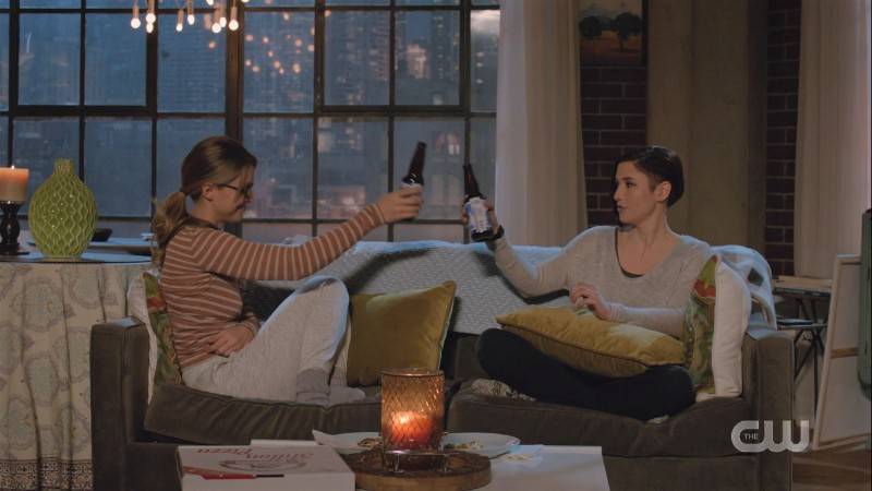 Danvers sisters cheers beer bottles on the couch