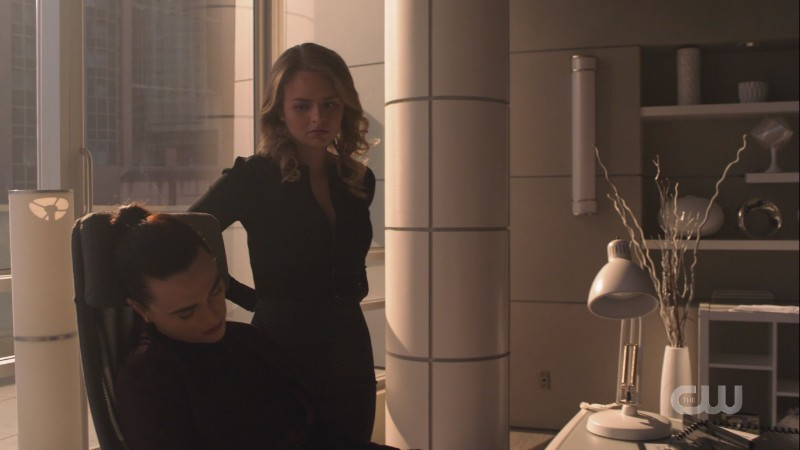 Eve looks down at Lena as if maybe she's having second thoughts