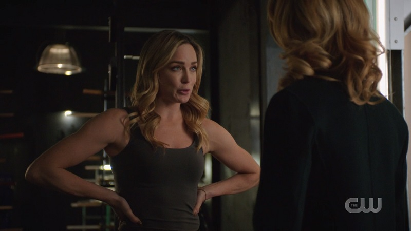 Sara has her hands on her hips and her ARMS are very muscley