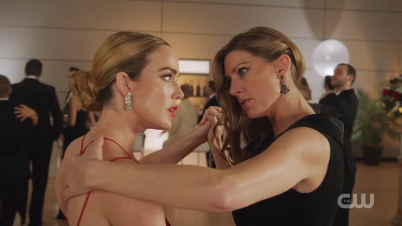 Sara and Ava hold each other and look focused on each other while they dance