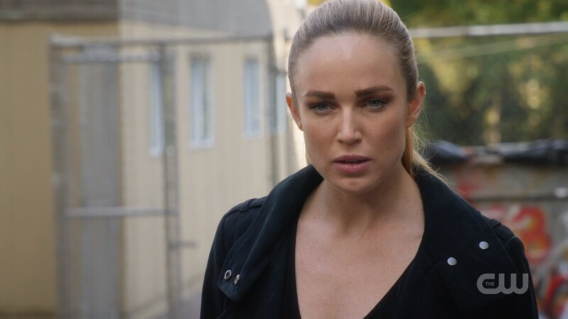 Sara is wearing a leather jacket and looks upset